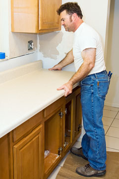 kitchen remodeling contractor installing cabinets and countertop
